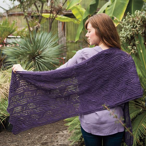 Model showing off the lace pattern of the Trellis Vince Poncho