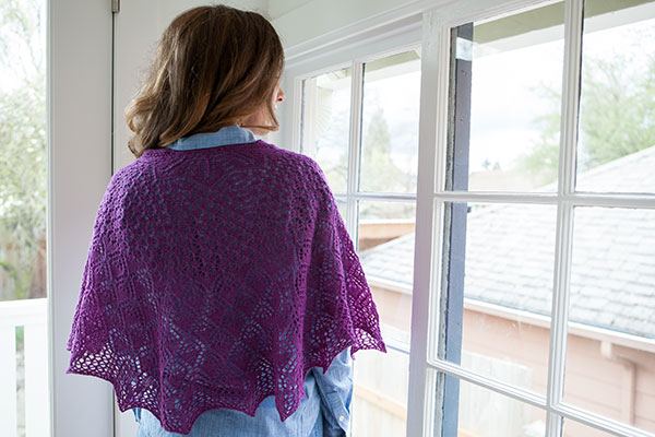Model wearing Emperatriz Shawl in front of a window.