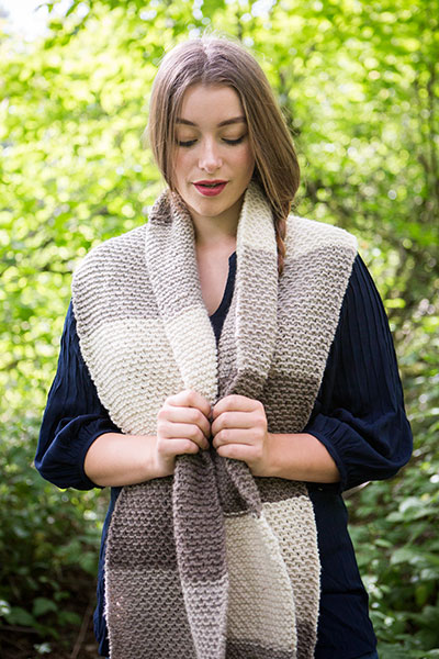 Model wearing the Simply Stripes Scarf in a forested area.