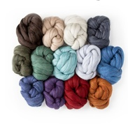 Various colors of wool roving in a pile