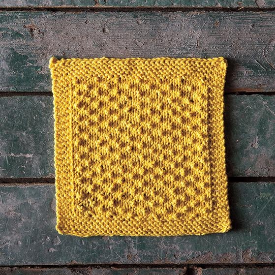 "Citrine Dishcloth: a yellow knitted dishcloth. Perky little nubbins in nice, orderly rows give this pattern just the right amount of texture to get the job done. The bumps are easy to make without any decreases or increases necessary, just clever little ""chains"" of knit stitches that pucker forward on the following row."